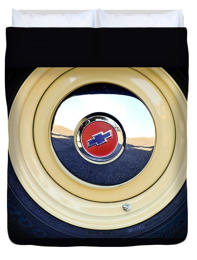 Chevrolet Duvet Cover featuring the photograph Chevrolet Wheel Emblem by Jill Reger