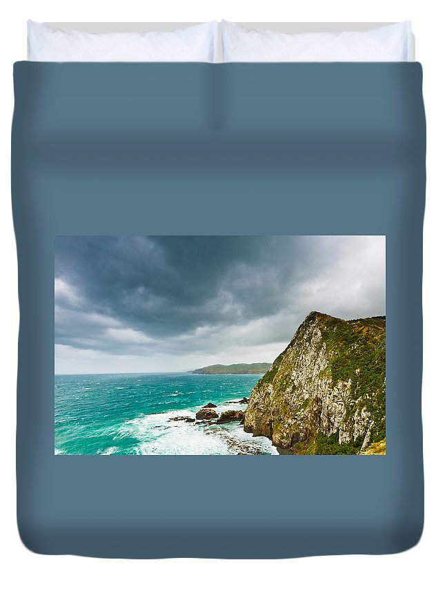Background Duvet Cover featuring the photograph Cliffs Under Thunder Clouds And Turquoise Ocean by U Schade