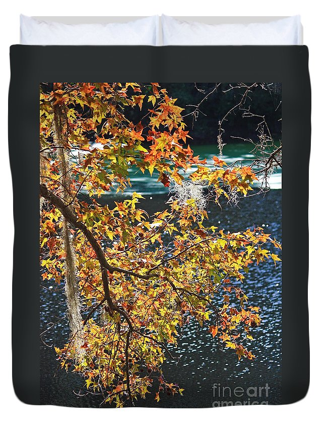 Fall Leaves Duvet Cover featuring the photograph Colorful Fall Leaves Over Blue Water by Carol Groenen