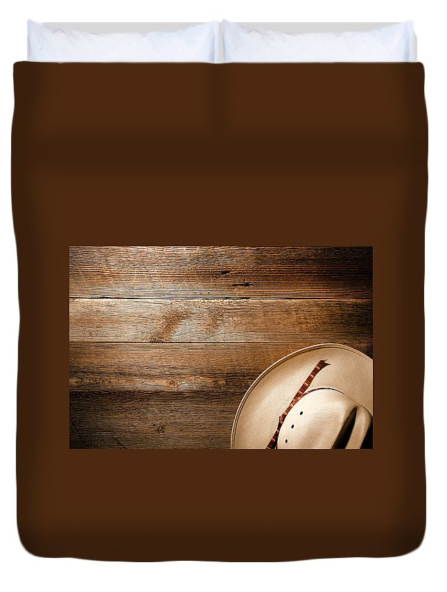Aged Duvet Cover featuring the photograph Cowboy Hat On Wood by Olivier Le Queinec