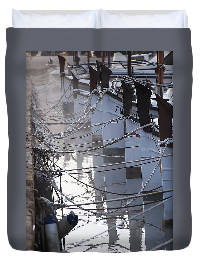 Nobody Duvet Cover featuring the photograph december's cold morning - A foggy day in port mahon with a line of traditional llaut boats by Pedro Cardona Llambias