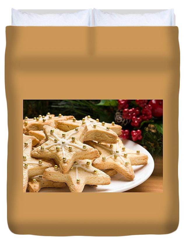Glazed Duvet Cover featuring the photograph Decorated Christmas Cookies In Festive Setting by U Schade