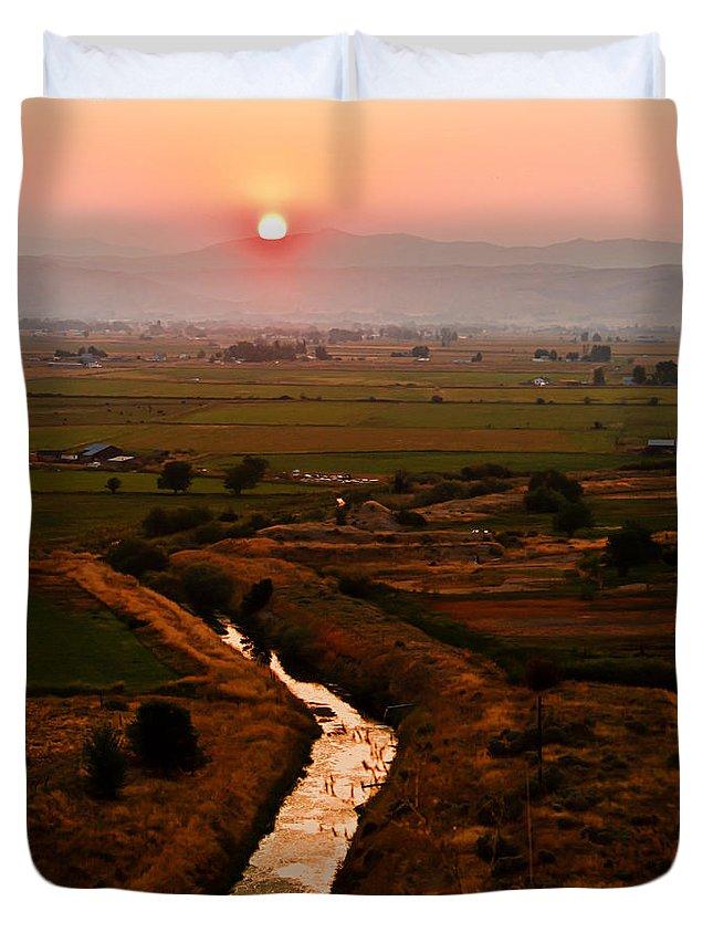 Sunrise Duvet Cover featuring the photograph Emmett Sunrise by Robert Bales