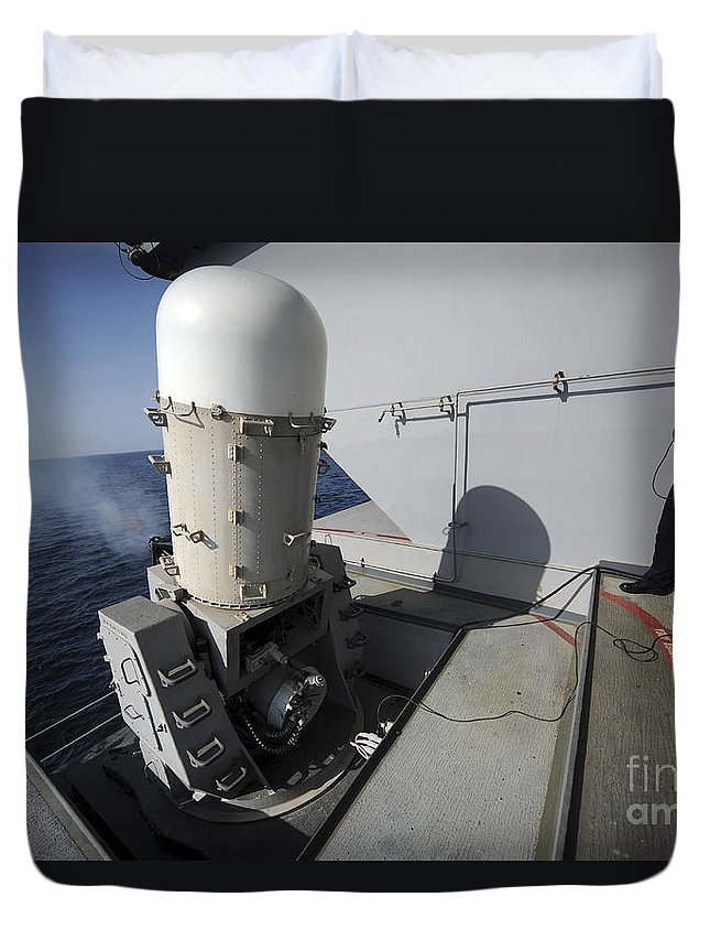 Ciws Duvet Cover featuring the photograph Fire Controlman Looks On As A Close-in by Stocktrek Images