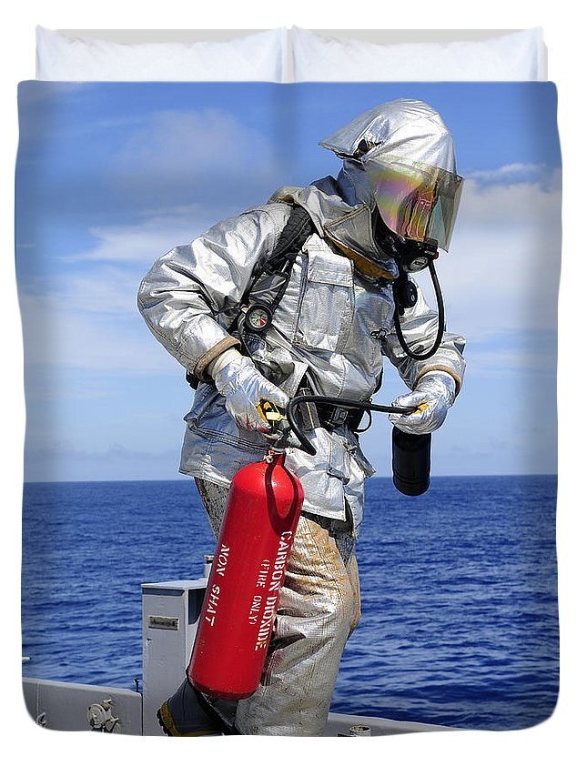 Us Navy Duvet Cover featuring the photograph Firefighter Carries A Co2 Fire by Stocktrek Images