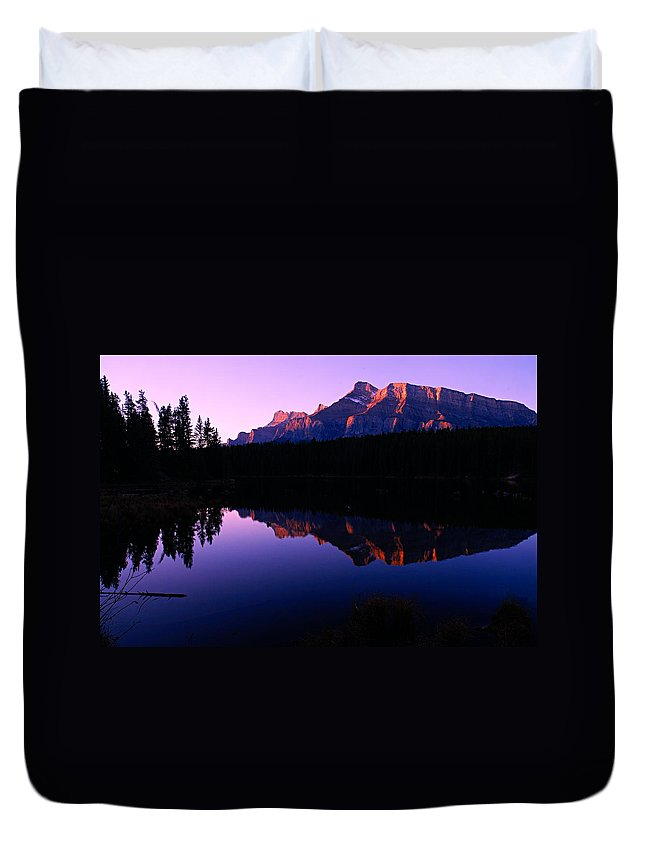 Mount Rundle Duvet Cover featuring the photograph First Light On Mount Rundle by Larry Ricker