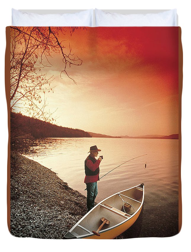 Light Duvet Cover featuring the photograph Fisherman by Darwin Wiggett
