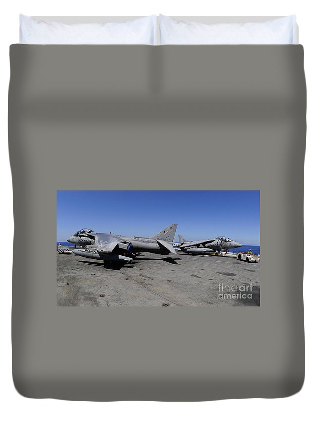 Plane Duvet Cover featuring the photograph Flight Deck Personnel Reposition Av-8b by Stocktrek Images