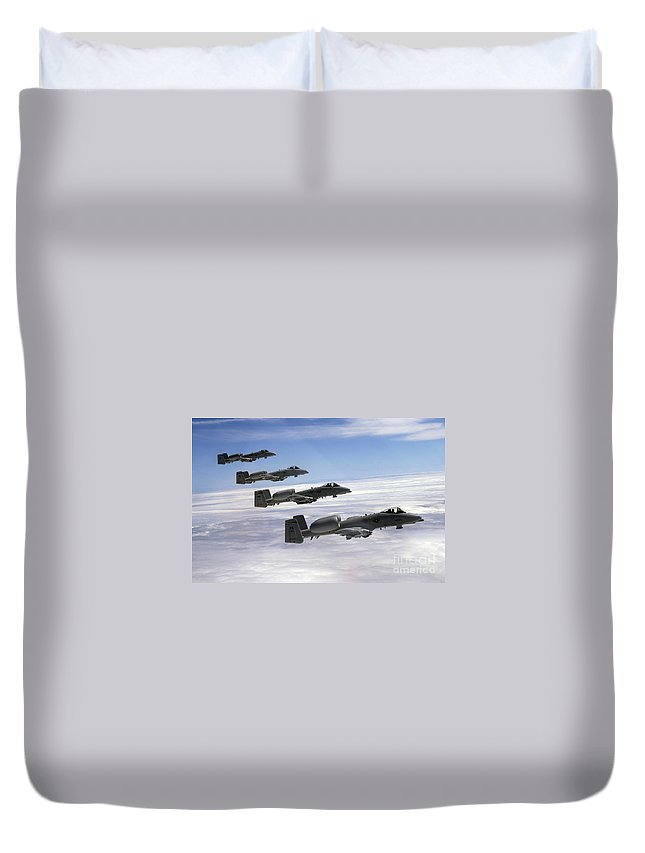 Horizontal Duvet Cover featuring the photograph Four A-10 Thunderbolt IIs Fly by Stocktrek Images