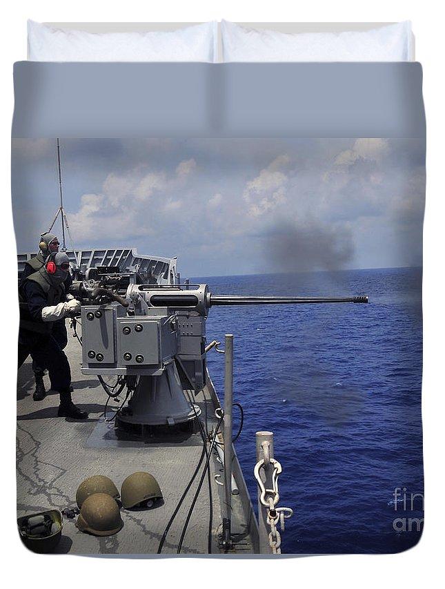 Submarine Tender Duvet Cover featuring the photograph Gunner Fires A Mark 38 Machine Gun by Stocktrek Images