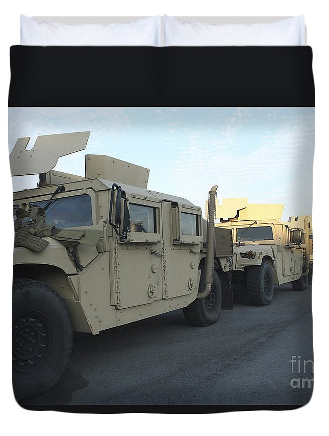 Humanitarian Assistance Duvet Cover featuring the photograph Humvees Sit On The Pier At Morehead by Stocktrek Images