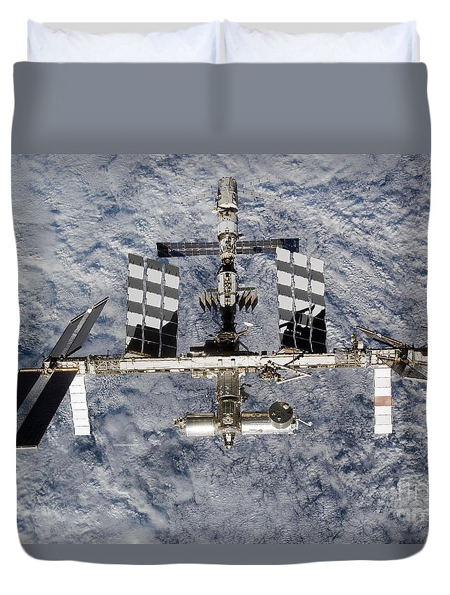 Aerial View Duvet Cover featuring the photograph International Space Station by Stocktrek Images