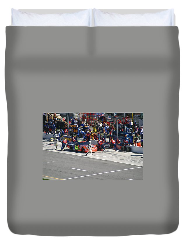 Nascar Racing Duvet Cover featuring the photograph Jeff Gordon Pit Crew In Action by Kym Backland