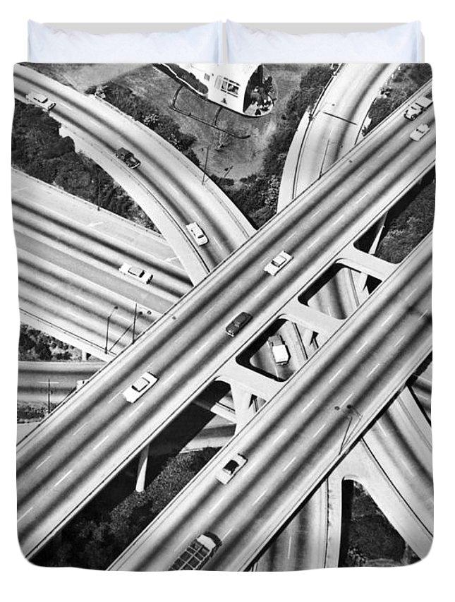 1960's Duvet Cover featuring the photograph La Freeway Interchange by Underwood Archives