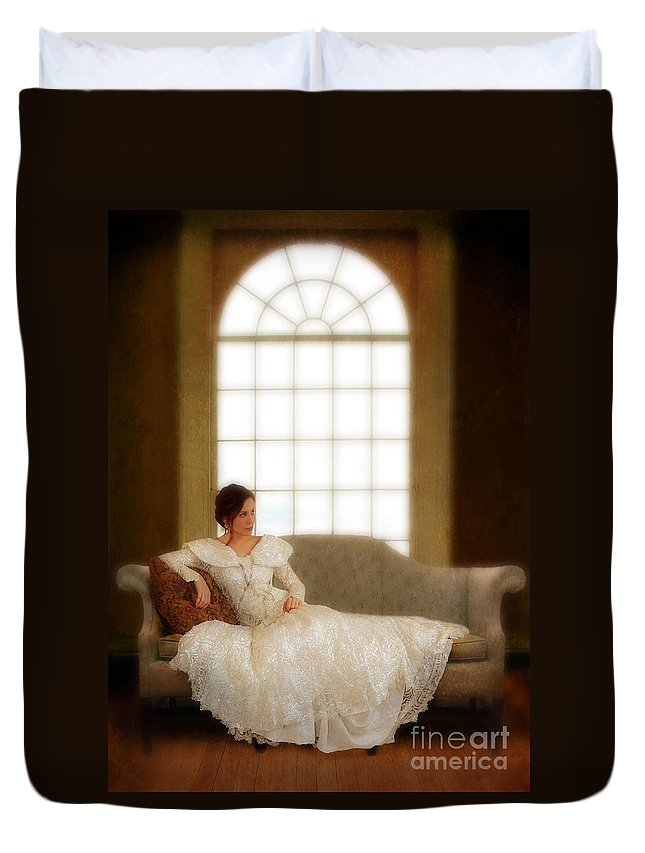 Beautiful Duvet Cover featuring the photograph Lady Sitting On Sofa By Window by Jill Battaglia