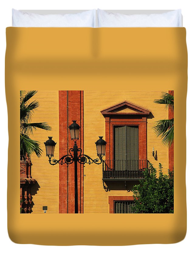 Sevilla Duvet Cover featuring the photograph Lamp And Window In Sevilla Spain by Greg Matchick