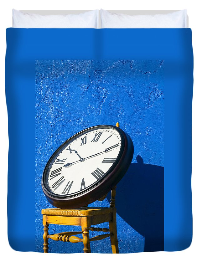 Clock Duvet Cover featuring the photograph Large clock on yellow chair by Garry Gay