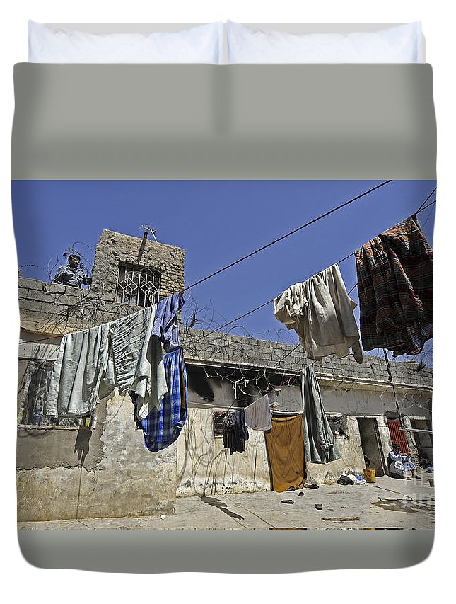 Operation Enduring Freedom Duvet Cover featuring the photograph Laundry Hangs In The Courtyard by Stocktrek Images