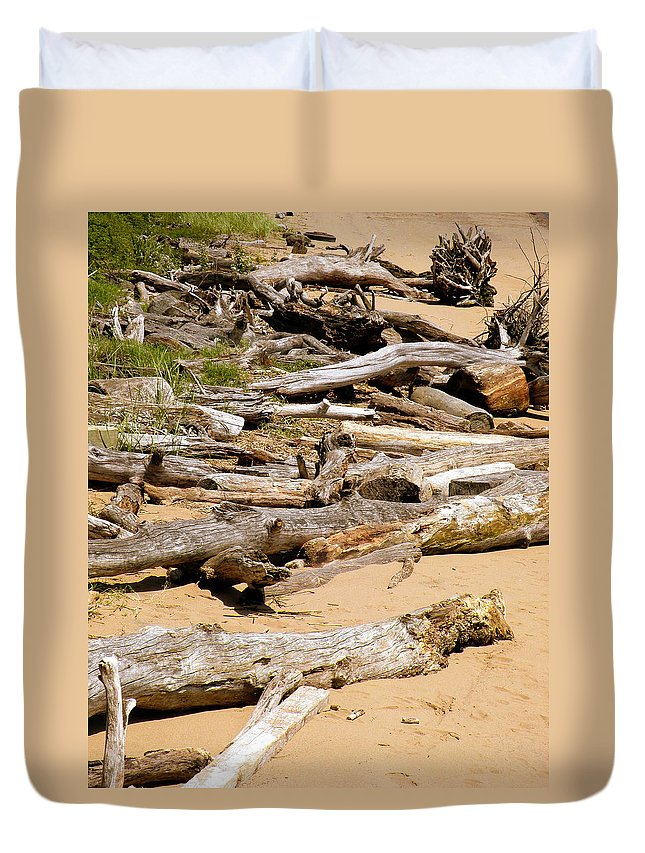 Driftwood Duvet Cover featuring the photograph Lonely Driftwood by Trish Tritz