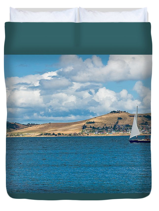 Beige Duvet Cover featuring the photograph Luxury Yacht Sails In Blue Waters Along A Summer Coast Line by U Schade