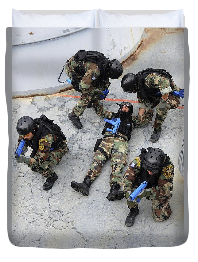 Rescue Duvet Cover featuring the photograph Members Of The Greek Navy Practice by Stocktrek Images