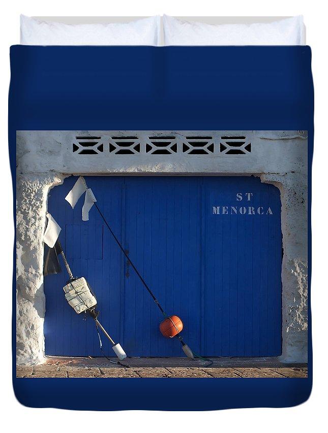 Orange Duvet Cover featuring the photograph menorca st - A warehouse door in Es Castell Menorca ready to keep local tradicional boats llauts by Pedro Cardona Llambias