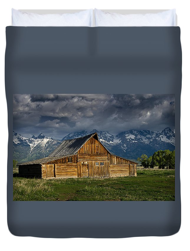 Grand Tetons Duvet Cover featuring the photograph Mormon Barn Under Approaching Storm by Greg Nyquist