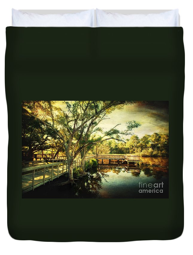 Ocean Springs Duvet Cover featuring the photograph Morning At The Harbor Park by Joan McCool