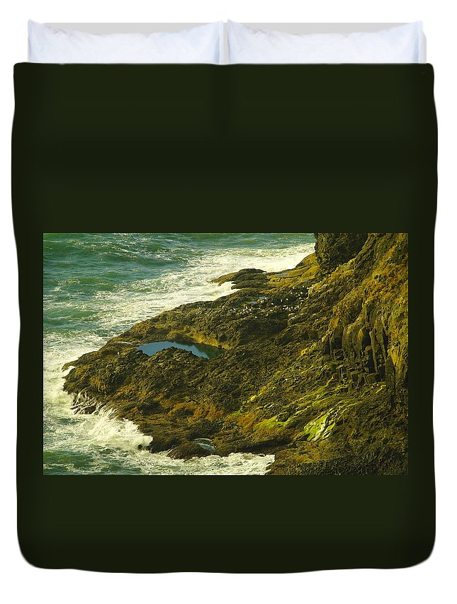 Water Duvet Cover featuring the photograph Ocean Pounded Rock by Jeff Swan