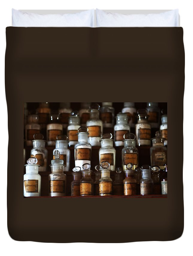 Old Duvet Cover featuring the photograph old pharmacy 2 - Old glass bottle with medicine powder of xviii century by Pedro Cardona Llambias