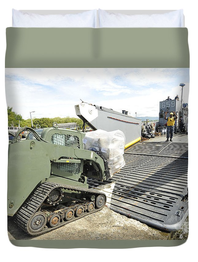 Colombia Duvet Cover featuring the photograph Pallets Of Donated Goods Are Removed by Stocktrek Images