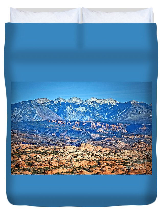 La Sal Mountains Duvet Cover featuring the photograph Petrified Dunes And La Sal Mountains by Tara Turner