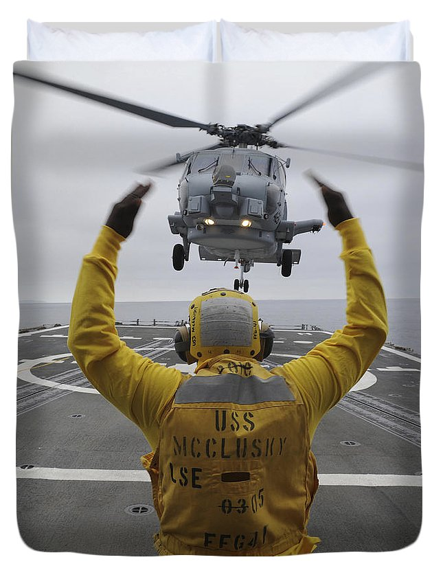 Guided Missile Frigate Duvet Cover featuring the photograph Petty Officer Guides An Sh-60r Sea Hawk by Stocktrek Images