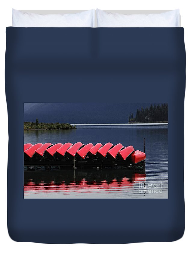 Red Canoes Duvet Cover featuring the photograph Red Canoes Maligne Lake by Bob Christopher
