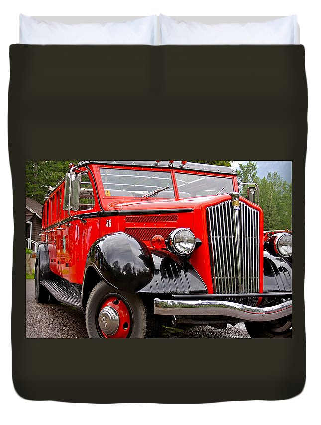Red Duvet Cover featuring the photograph Red Jammer Tour Bus Glacier National Park by Karon Melillo DeVega