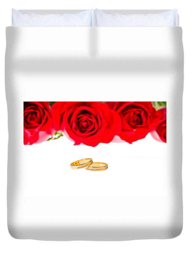 Backgrounds Duvet Cover featuring the photograph Red Roses And Wedding Rings Over White by U Schade