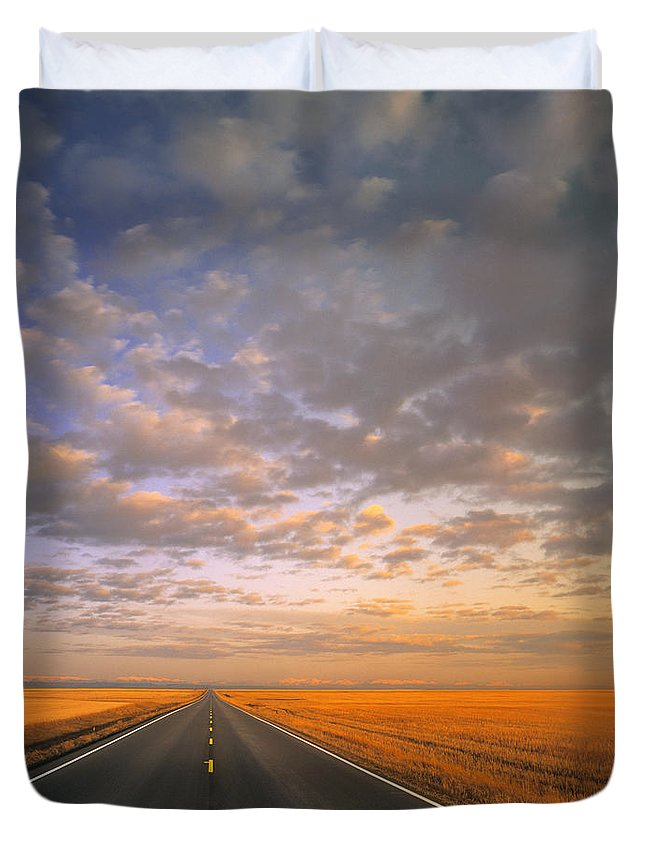 Light Duvet Cover featuring the photograph Road Into Sunset by Darwin Wiggett