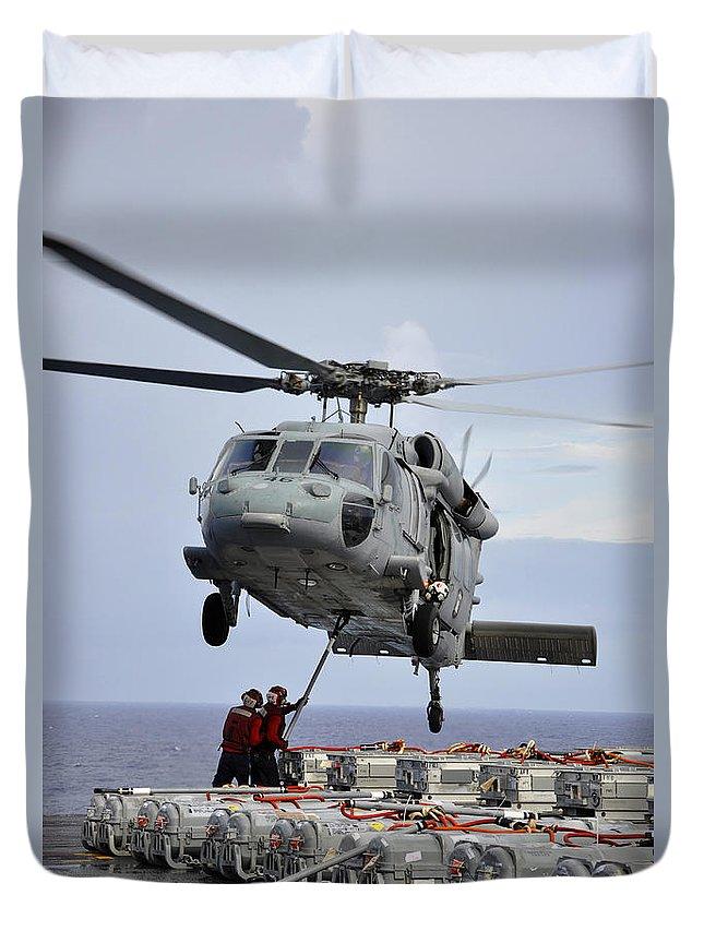 Pacific Ocean Duvet Cover featuring the photograph Sailors Hook An Ammunition Pallet To An by Stocktrek Images