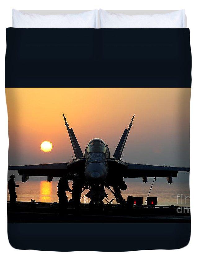 Flight Operations Duvet Cover featuring the photograph Sailors Prepare An Fa-18c Hornet by Stocktrek Images