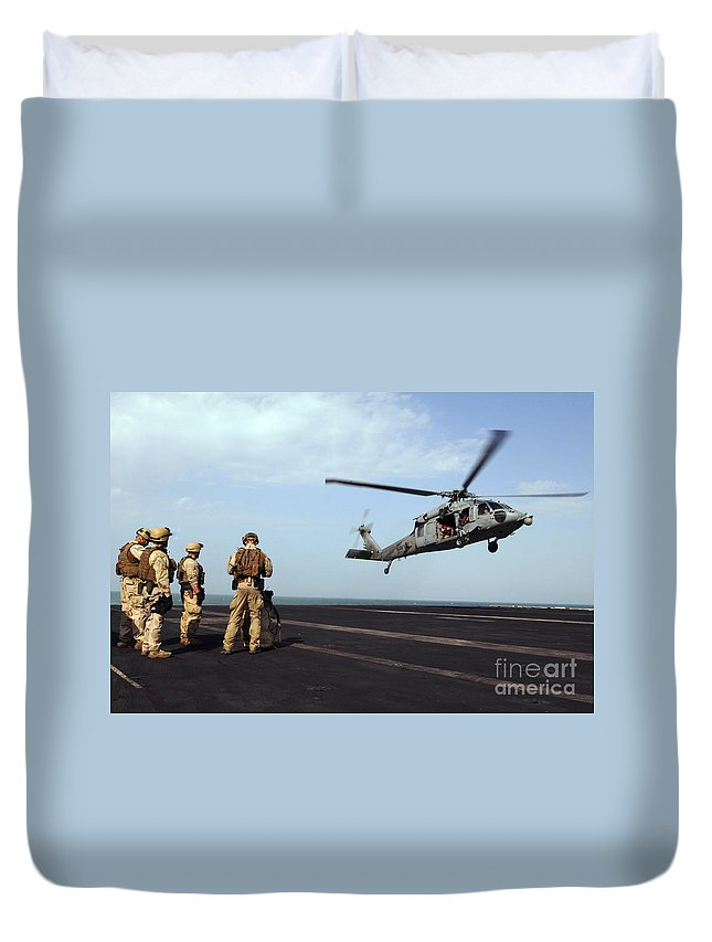 Aircraft Carrier Duvet Cover featuring the photograph Sailors Prepare To Board An Mh-60s Sea by Stocktrek Images