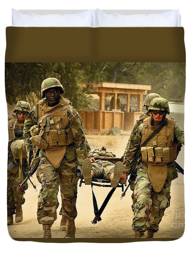 Naval Mobile Construction Battalion Duvet Cover featuring the photograph Seabees Conduct A Mass Casualty Drill by Stocktrek Images