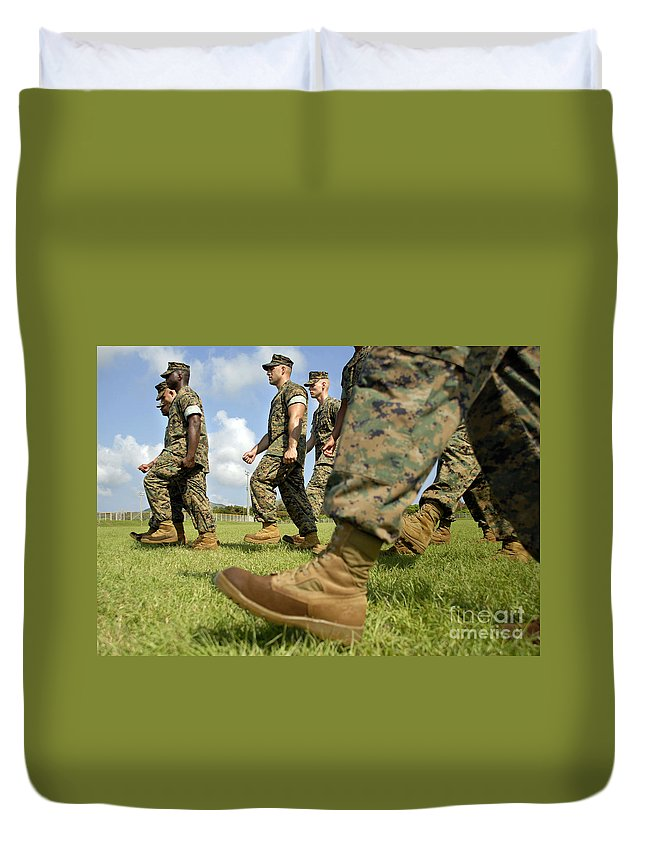Boots Duvet Cover featuring the photograph Sergeant, Foreground, Leads A Small by Stocktrek Images