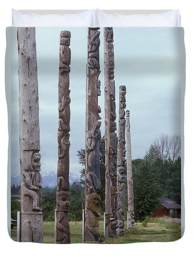 Six Wooden Totem Poles Stand In A Row Duvet Cover