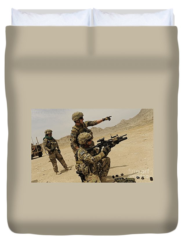 Army Duvet Cover featuring the photograph Soldier Directing A Fellow Soldier by Stocktrek Images