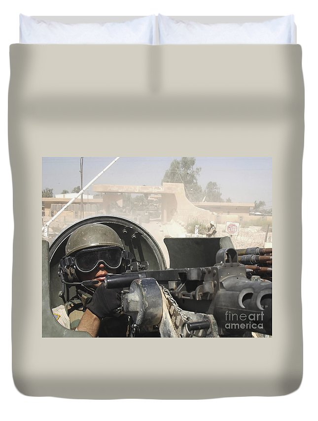Color Image Duvet Cover featuring the photograph Soldier Pulls Security From The Hatch by Stocktrek Images