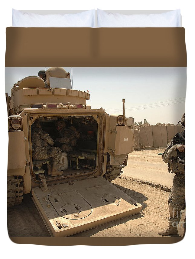 Army Duvet Cover featuring the photograph Soldiers Climb Into The Back Of A M2 by Stocktrek Images