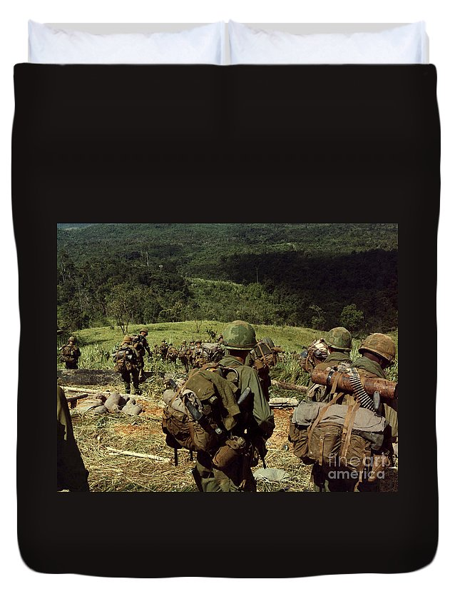 Dak To Duvet Cover featuring the photograph Soldiers Descend The Side Of Hill 742 by Stocktrek Images