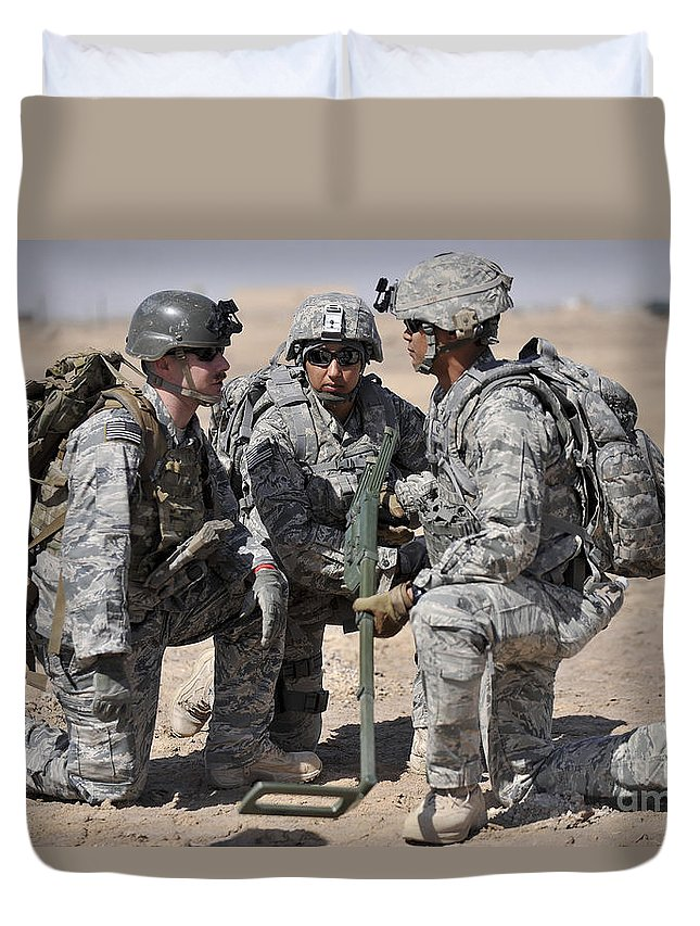 Iraq Duvet Cover featuring the photograph Soldiers Discuss A Strategic Plane by Stocktrek Images