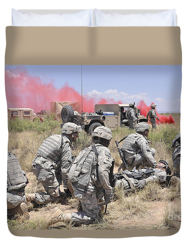 White Sands Missile Range Duvet Cover featuring the photograph Soldiers Prepare To Transport A Wounded by Stocktrek Images