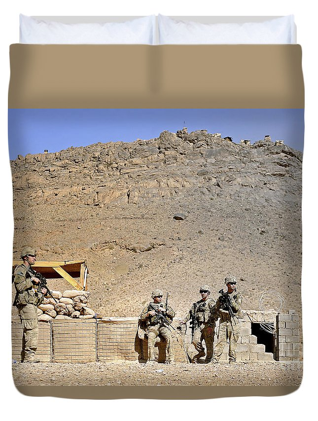 Provincial Reconstruction Team Duvet Cover featuring the photograph Soldiers Wait For Afghan National by Stocktrek Images